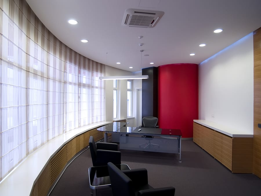 Interior of a modern office with chairs and table